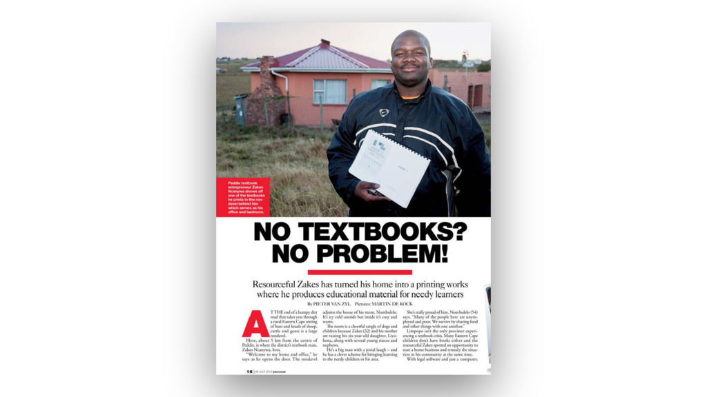 A page from a magazine, headline 'No Textbooks? No Problem!' and a photograph of a man holding a printout, outside a rural home.